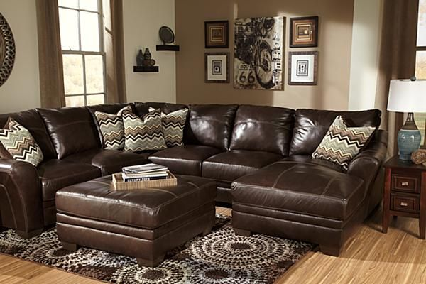 The Beenison - Chocolate Sectional from Ashley Furniture HomeStore (AFHS.com). Upholstery features top-grain leather in the seating areas with skillfully matched DuraBlend® upholstery everywhere else.