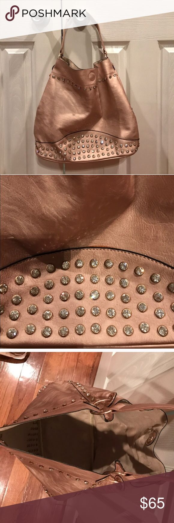 Rosegold Diamond Studded Purse! Rosegold Diamond Studded Purse! From Rosetree! Never used. All rhinestones are still in tact. Also comes with a mini bag that goes down inside the purse! Beautiful bag! Rose Tree Bags Shoulder Bags