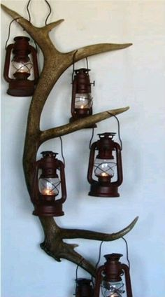 Antler with lanterns hanging from it! There are so many things you could hang from an elk antler attached to a wall. Great idea!