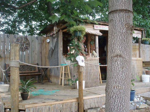 Garden shed turned tiki bar for Garden shed bar
