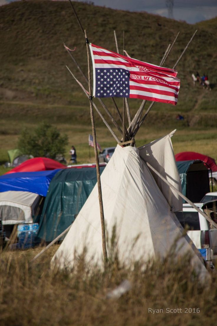 Upside down American Flag distress signal at Sacred Stone Camp, Standing Rock Reservation. Water is Life! Protect our waters! No DPL!  Photo Credit: Ryan Scott http://liquidinkphotography.pixieset.com/standingrockindianreservationnd/
