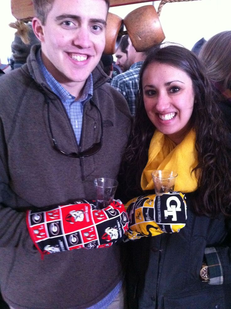 A cute couple wearing our mitts, in state rivals, Georgia and Georgia Tech!