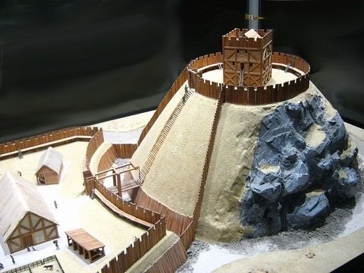 A brilliant model of a Motte and Bailey. You can see the elevated keep on the tallest part of the Motte; and a slightly elevated domestic area on the Bailey below.