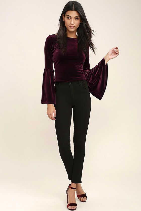 The Look to the Moon Burgundy Velvet Long Sleeve Crop Top will have you out all night! Super soft velvet shapes a rounded neckline, V-back, and long bell sleeves. Cropped bodice.