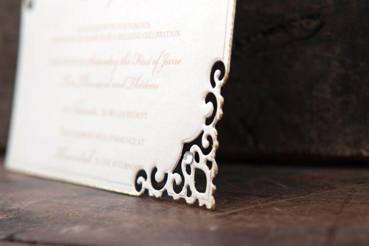Die cut corner detail on an invitation card