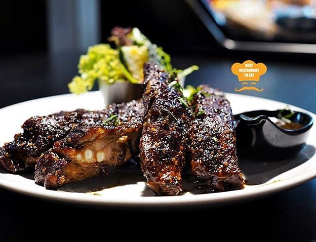 Juicy and Finger Licking Oven-baked Pork Ribs which is coated with specialityBlack Sauce.  #porkribs #TrulyWine #wine #food #damansara #uptown
