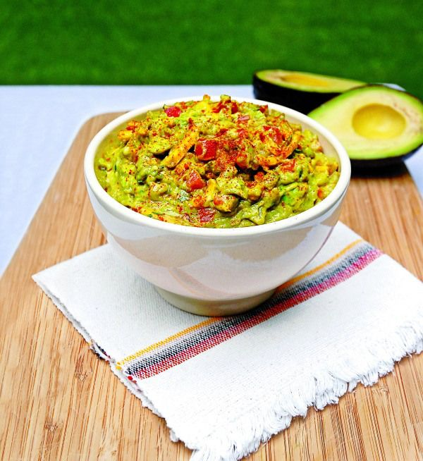 Chrissy Teigen's cheesy guacamole:   Ingredients:  3 ripe avocados  Juice of 1 lime  1/2 tsp. kosher salt  1/2 tsp. ground cumin  1/4 tsp. pepper  1/2 tsp. cayenne dash of garlic powder  1 diced tomato  1 tbsp. chopped cilantro  1 small yellow onion, diced  2 cloves garlic, minced  1 cup grated cheddar cheese