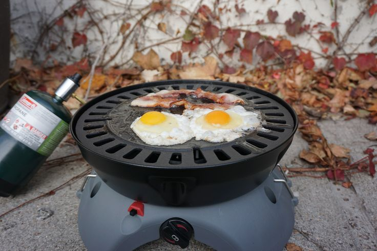 This is The Ultimate ALL-IN-ONE ALL PURPOSE CAMP GRILL   Eureka Gonzo Grill Cooking Eggs and Bacon ($190)