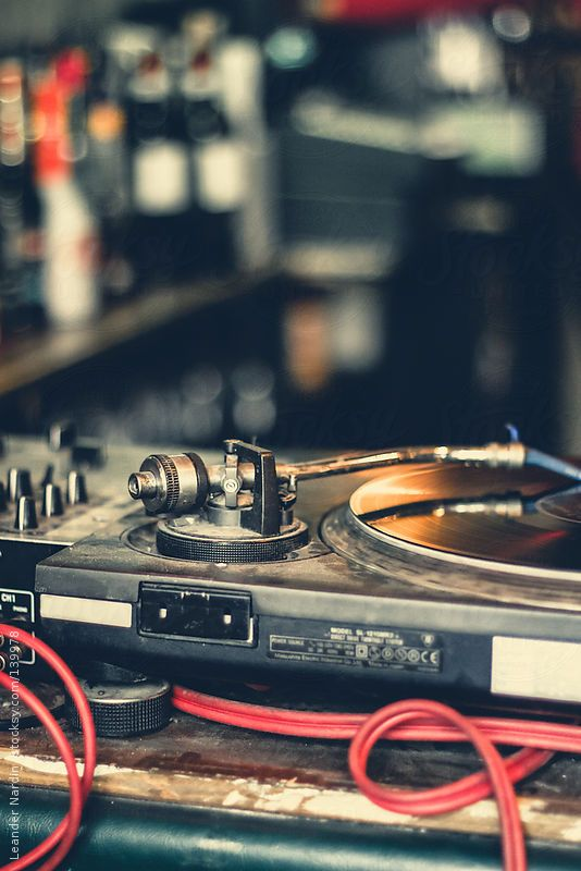 DJ equipment with turntable and mixing console by Leander Nardin