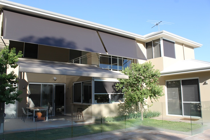 Modern Retractable Blinds and Awnings. The owners of this newly renovated home installed Issey awnings and blinds to their windows, balconies and patio area to combat the heat and glare of the low afternoon sun. The shades are motorised and retract at the touch of a button allowing the sun's warmth inside during those cool winter months.