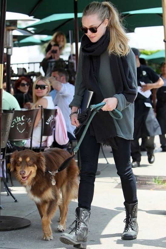 Amanda on a walk with her dog looking casual and relaxed.