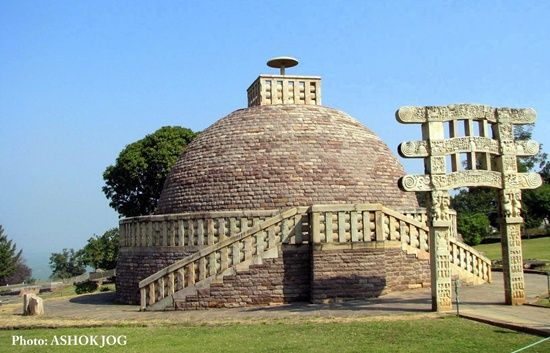 Sanchi Stupa, India: This one is the oldest structure of stone in India and was originally commissioned in the 3rd Cetury BCE by Ashoka the great. It was crowned by the Chatra which is shaped like a parasol showing that it was of high rank. This structure was supervised by Ashoka's first wife the empress Vidisha Devi personally.