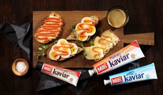 Mills Kaviar. Norwegian salty bread spread made of cod roe. Use on top of egg slices or with mayo and cucumbers. Some like the salty taste with gauda cheese. The blue tube is the best.