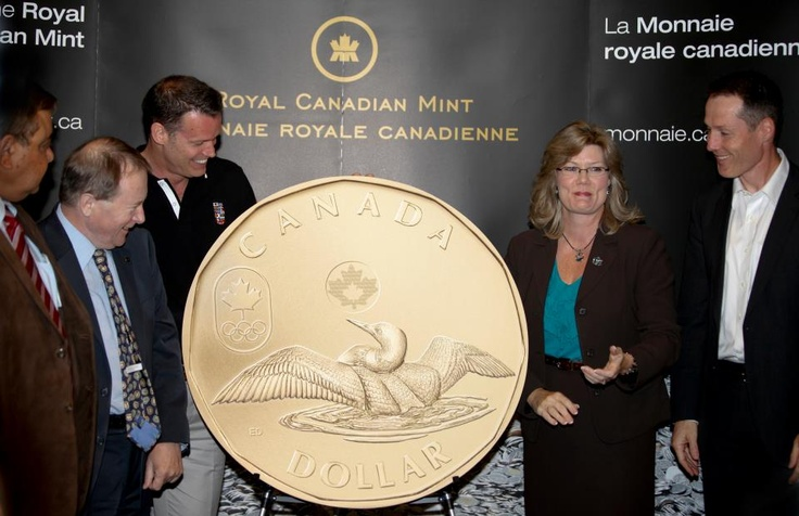 The 2012 Lucky Loonie presented by the Royal Canadian Mint to Mark Tewksbury, Chef de Mission for the 2012 Canadian Olympic Team at Canada's Sports Hall of Fame in Calgary, AB.