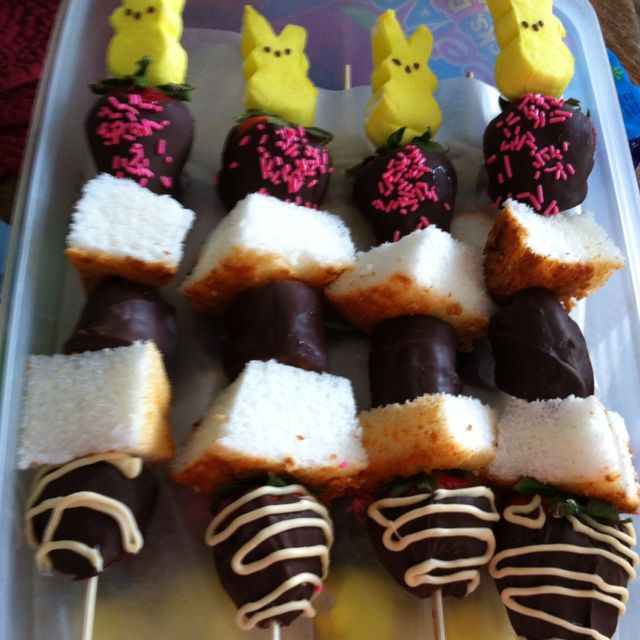 Easter dessert fruit kabobs...choc covered strawberries and bananas layered w angel food cake topped w a Peep! Maddie and I made these :)