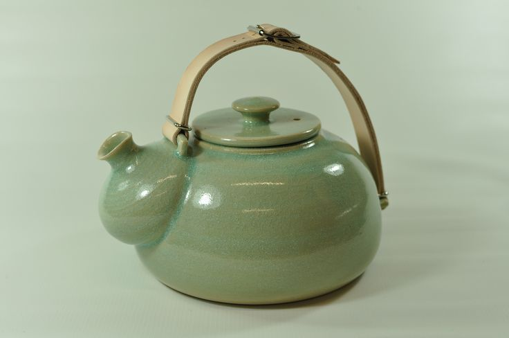 Teapot with a leather handle