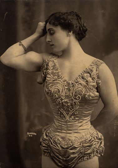 Circus strong woman, 1905 - They put a strong woman in the circus! My, how times have changed. Thankfully!