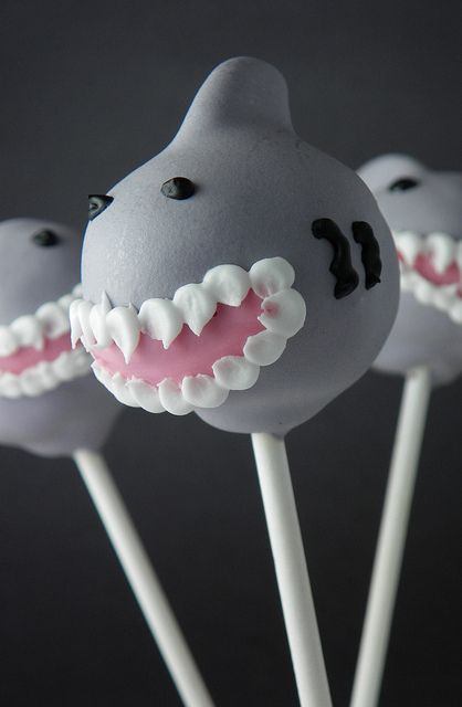 Shark cakepops!! May have to make these to celebrate SHARK WEEK! NEXT WEEK! YAY!!!!