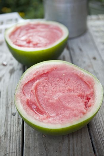 watermelon-lime-sorbet: frozen in the hollowed out watermelon rind. When time to serve, cut into wedges just like a real watermelon. No bowls or utensils needed! So clever! Love!!