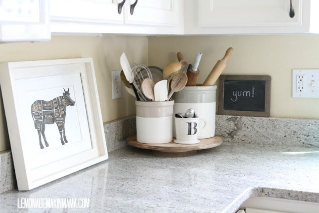 Great idea for corralling your cooking utensils.  I love the measuring spoons in a cute coffee cup.