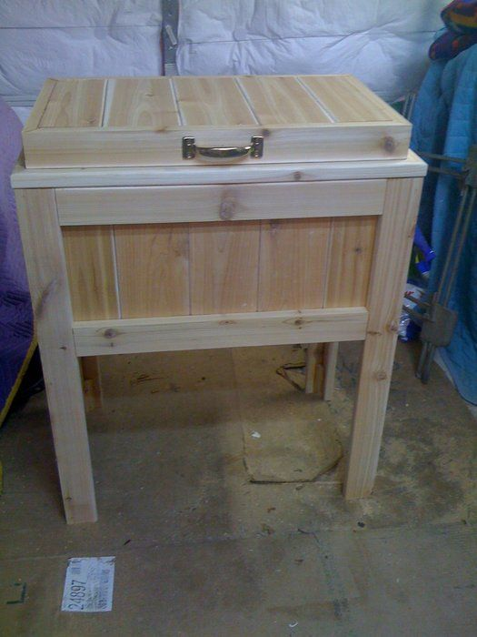 get the DIY project card for this cedar chest for your deck... the lid lifts up to reveal a 48qt Igloo cooler.