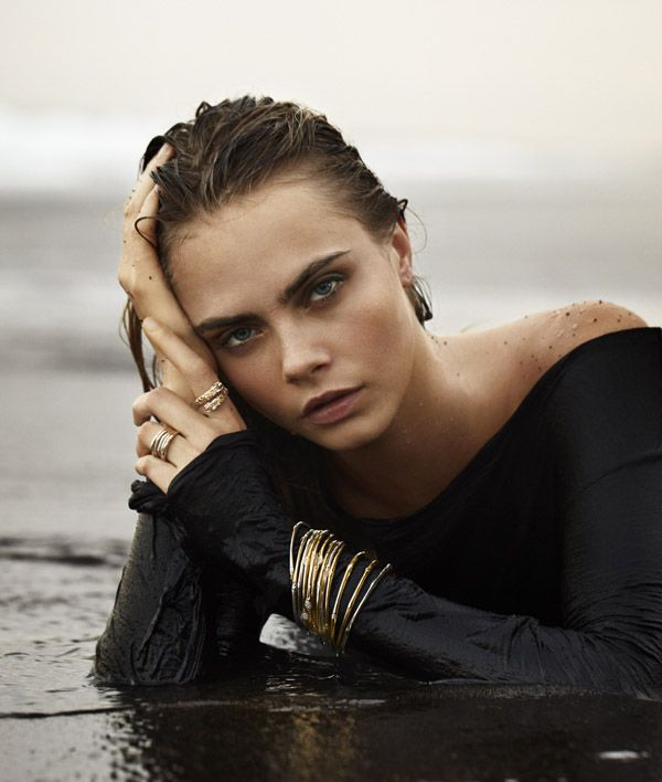 11 Unbelievable Photos of Cara Delevingne Lying on Things While Wearing Jewelry  - MarieClaire.com