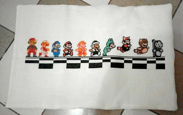 I made this super mario pillow for my fiance found the chart in spritestitch.com
