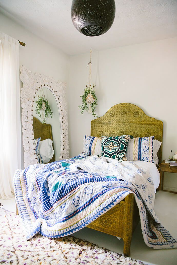 upholstered bed & carved floor mirror