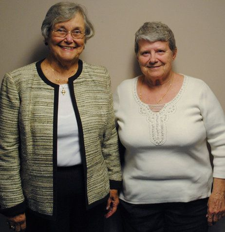 Sally Edwards (left), 80, and Lue Hutchinson, 71, visited StoryCorps in Cincinnati. Their sons, Jack Edwards and Tom Butts, are buried at Ar...