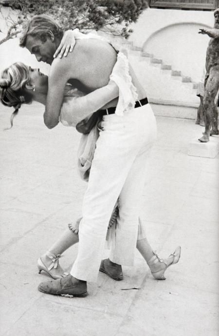 Candice Bergen and Michael Caine try out a tango to pass the time, 1967.