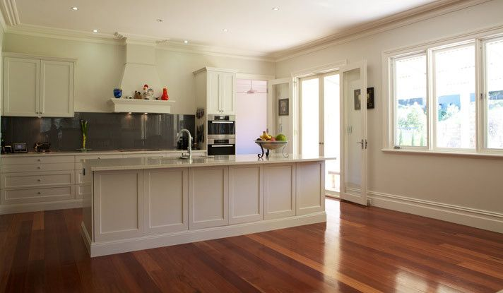 White country style kitchen with grey glass splashback