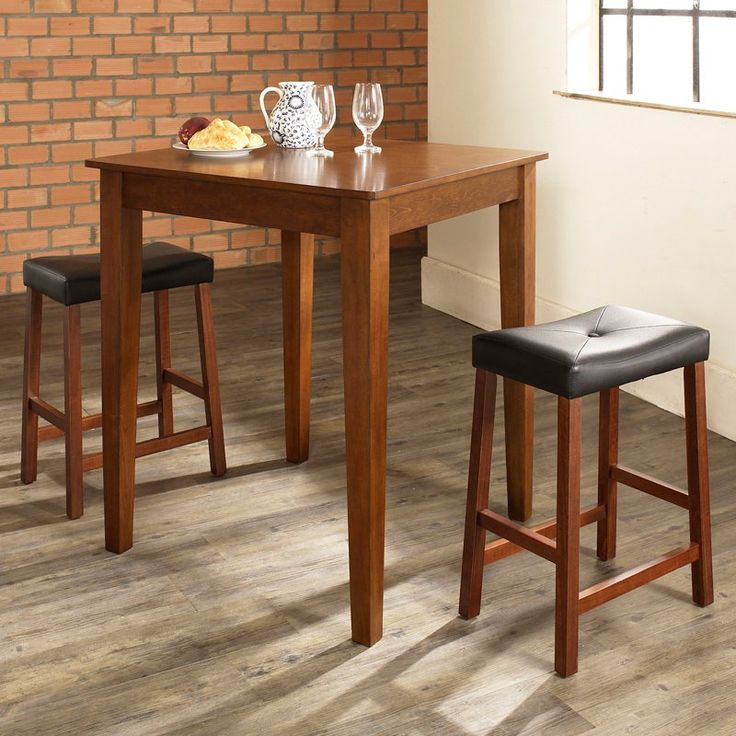 Crosley 3-Piece Pub Dining Set with Tapered Leg and Upholstered Saddle Stools | from hayneedle.com