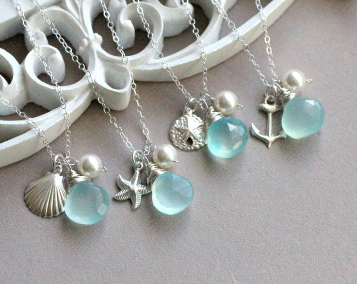 GIFT SET of FOUR Bridesmaid Necklaces, Beach Wedding, Ocean Theme, Nautical Theme, Anchor, Sea Shell, Starfish, Sand dollar, Aqua Blue. $144.00, via Etsy.:
