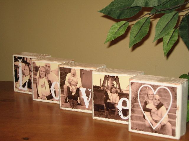 Mimo - I think I want to do this for your Gifts table.  I can buy the wood, it's only like $3 bucks but I'll need Elvis to cut it w/ his saw.  I can sand out the edges and  I'll find 5 photos of you guys.  I have this round box w/ a lil boy and lil girl kissing that we could use for your card box if we can't find a wooden suitcase.  I'll fb you a picture of my box.