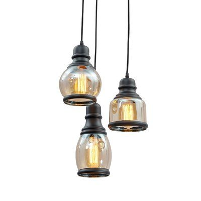 Three's a charm. Slightly kinked cords and a trio of uniquely styled seeded glass shades give this pendant light delightfully eclectic appeal. Adjustable cord length allows you to create the perfect staggered effect.