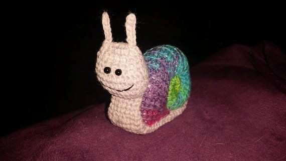 Handmade crocheted Rainbow Snail with a happy face. Snails can be made with different coloured shells, message me if you wish to request one. Measurement: approximately 8cm tall An original creation from a pattern by 'When they live their own lives…' designed by Masha