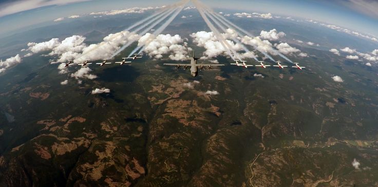 An #RCAF CC-130J Hercules #FlyingInFormation alongside The Canadian Forces Snowbirds' CT-114 Tutors <--- Beautiful image!