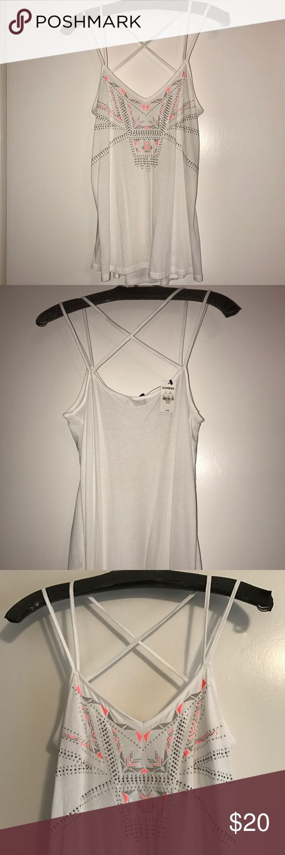 Express Women's Aztec studded tank NWT Medium NWT, never been worn Express Aztec print tank with strappy back. White with pink and silver accents as well as silver studs. Flowy tank with criss crossed straps on the back. Express Tops Tank Tops