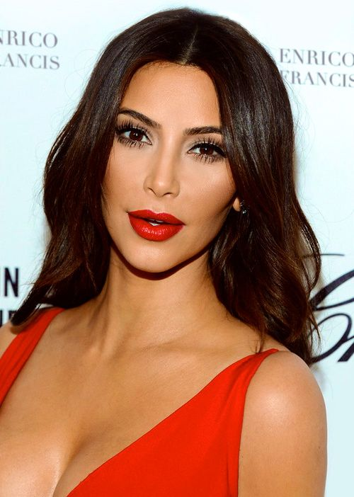 Not a fan of Kim K, but like the lashes and red lips with the dark brown hair