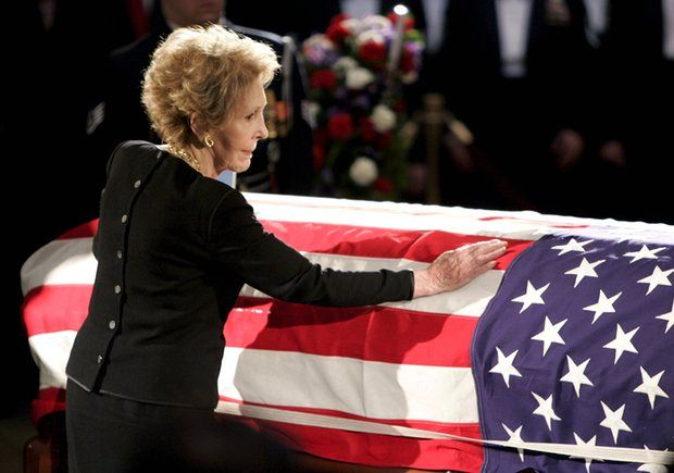 Nancy Reagan touches the casket of her husband
