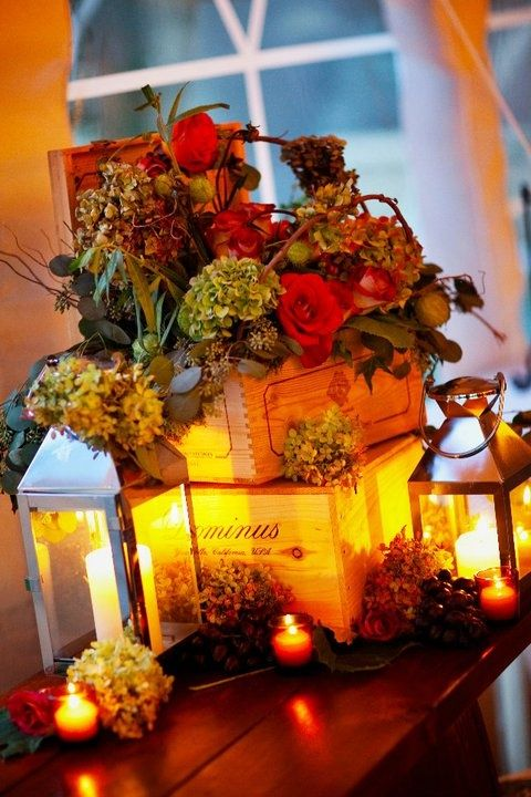 Loving the gorgeous golden warmth of the lit #candles against the cigar box #centrepieces