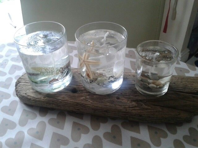 Gel candles with seaglass, shells and pebbles, on driftwood