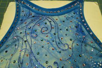 Sk8 Gr8 Designs. Custom application of Swarvorski rhinestones in Crystal AB and Blue Zicron AB onto a ready to wear ice skating dress. www.sk8gr8designs.com