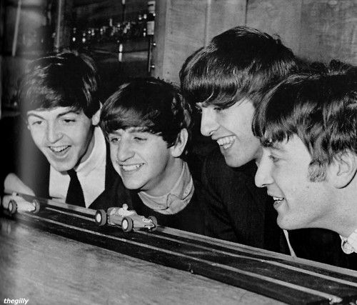 "Backstage at the Coventry theatre on 17 November 1963 playing with scalextric toy cars. Photo by Terence Spencer. Scan from ""The Beatles: Then There Was Music"" by Tim Hill."