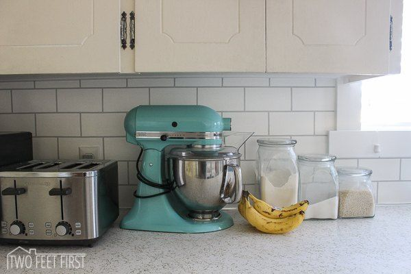 Do you want a cheap way to update your kitchen backsplash? How about for just $22 dollars? Here is how we added a subway tile look to our backsplash using paint…