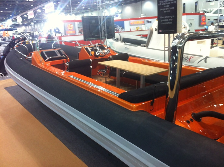 Custom rib x tender with flexiteek deck and table! Lamborghini orange...