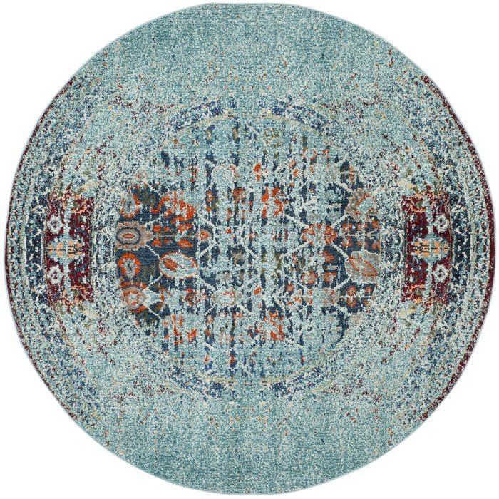 An over-dyed motif gives this multicolor rug a look that adds a boho touch to any space. Use it to level out a neutral living room arrangement or to define space in the den.