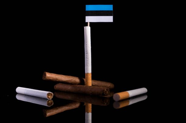 estonia flag with cigarettes and cigars tobacco industry concept