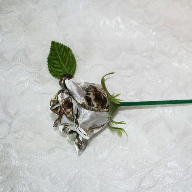 White Camo Rosebuds on Pic for Camo Bridal Bouquets or other Camo Décor.