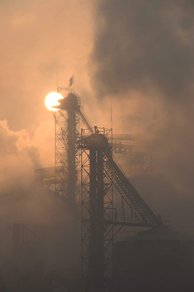 Chimneys of a cement plant emit smoke into the air in Binzhou, in east China's Shandong province. Air pollution is a major problem in China due to the country's rapid pace of industrialisation, reliance on coal power, explosive growth in car ownership and lack of environmental regulation. It typically gets worse in the winter because of weather conditions and an increase in coal-burning for heating needs Photograph: Zhang Bin/EPA